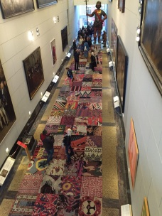 This hall has rugs reprenting every country of immigrant citizens