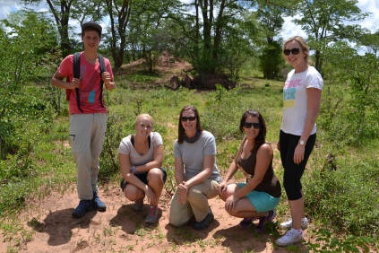 Volunteer photo in front of the rhinos