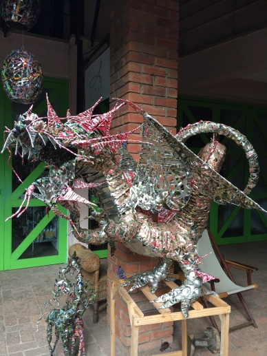 Huge dragon made from cans & bottle caps