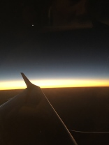 Crescent moon off the wing at sunset