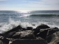 Waves crashing at the end of the jetty